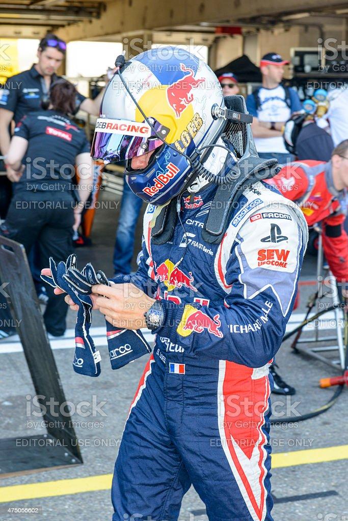 Sebastien Loeb racing driver in the pit lane stock photo