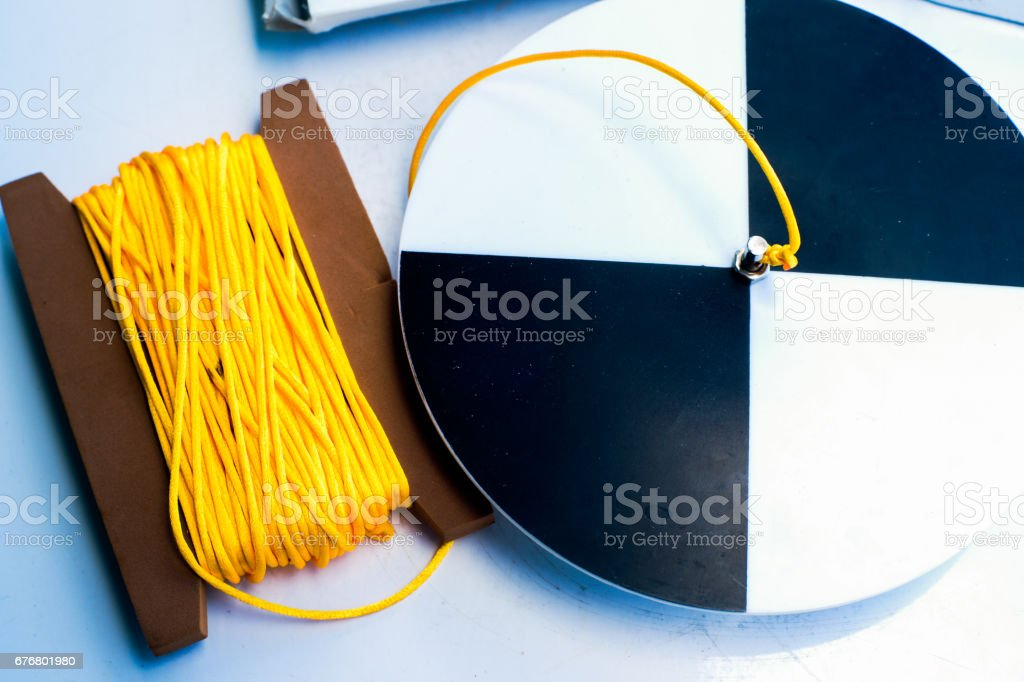 Secchi disk with rope on a white table stock photo