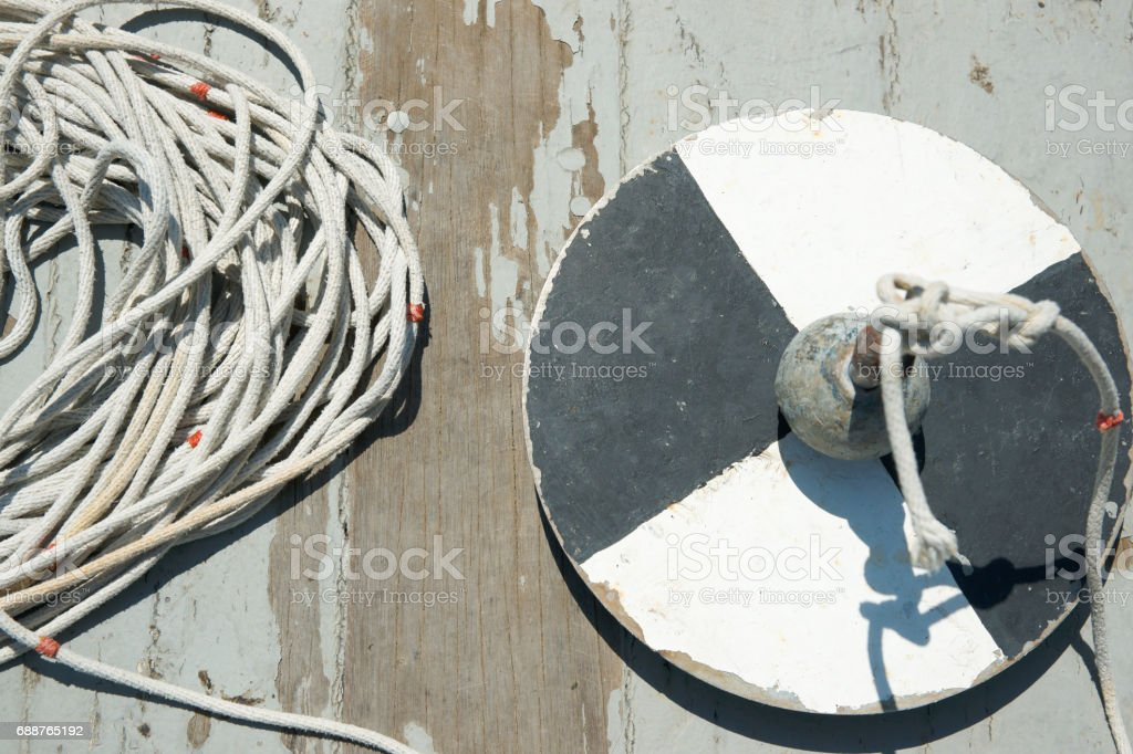 Secchi disk with rope on a wooden dock, water transparency measurement. stock photo