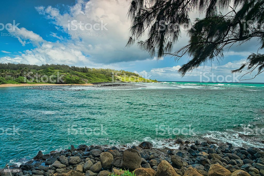 Secluded Beach on Kauai Hawaii With Rocky Shore stock photo