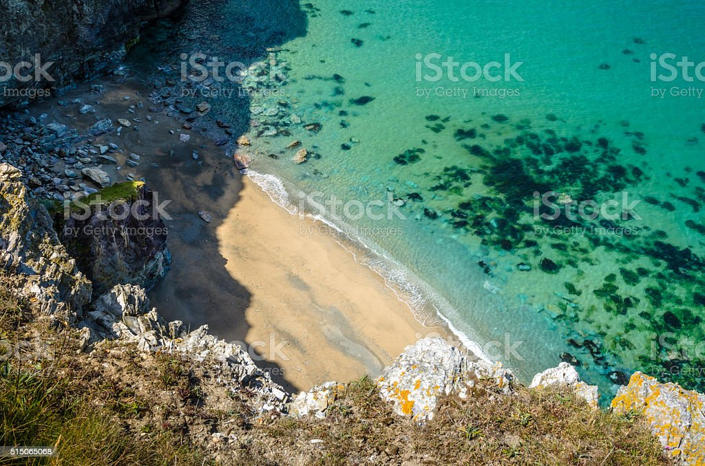 Secluded Sandy Beach at the foot of a High Cliff stock photo