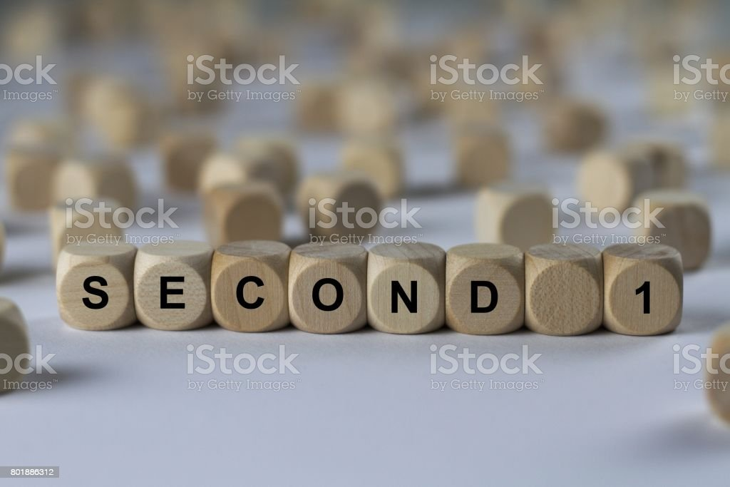 second 1 - cube with letters, sign with wooden cubes stock photo
