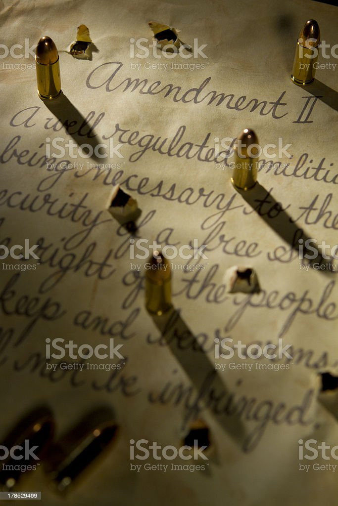 Second amendment with bullets casting shadows onto the document stock photo