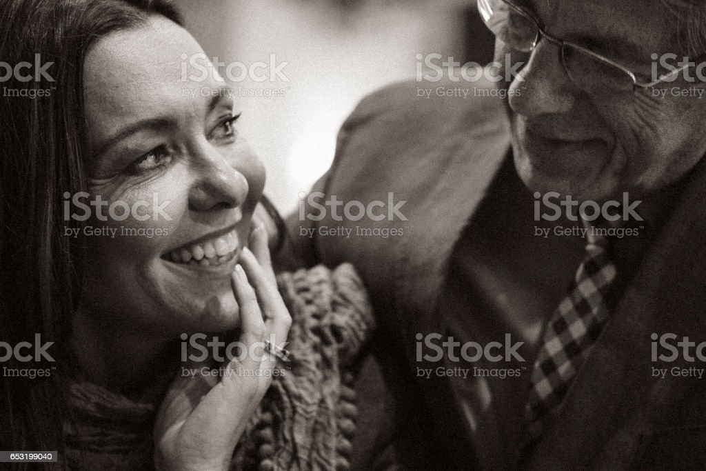 A second chance... First romantic evening in a cafe for a mature couple after some years of solitude. The woman is acting in shyer manner than the man. stock photo