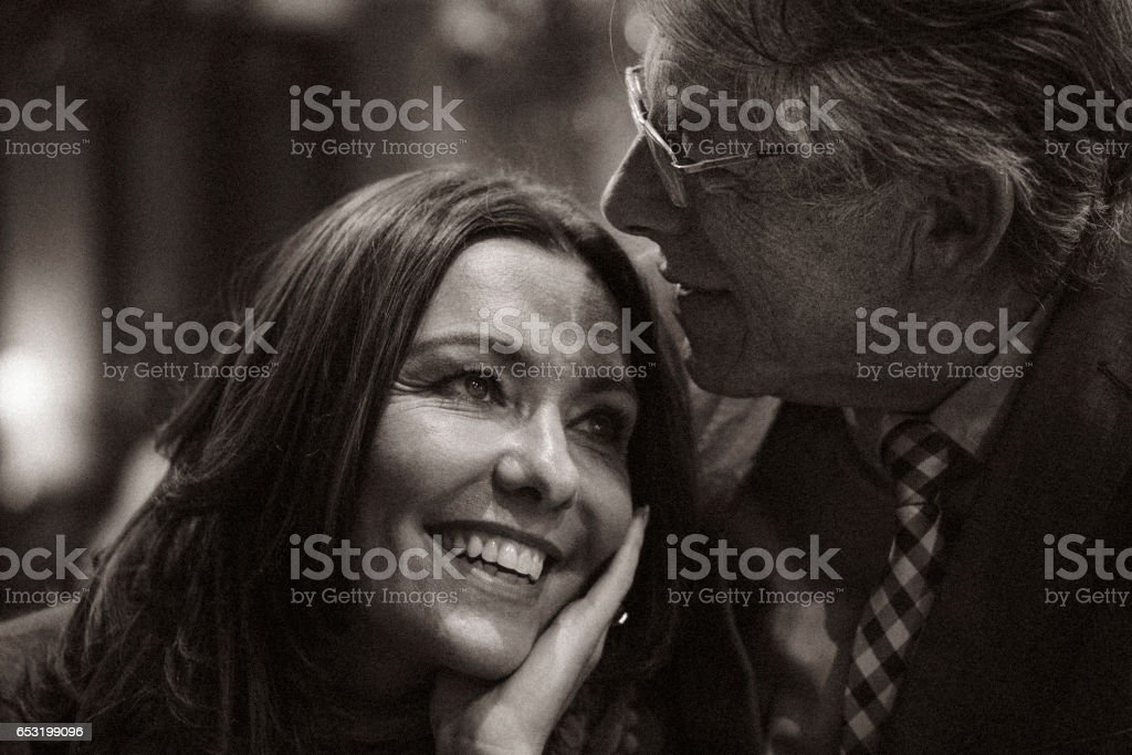 A second chance... Romantic evening in a cafe for a mature couple falling in love after some years of solitude. stock photo
