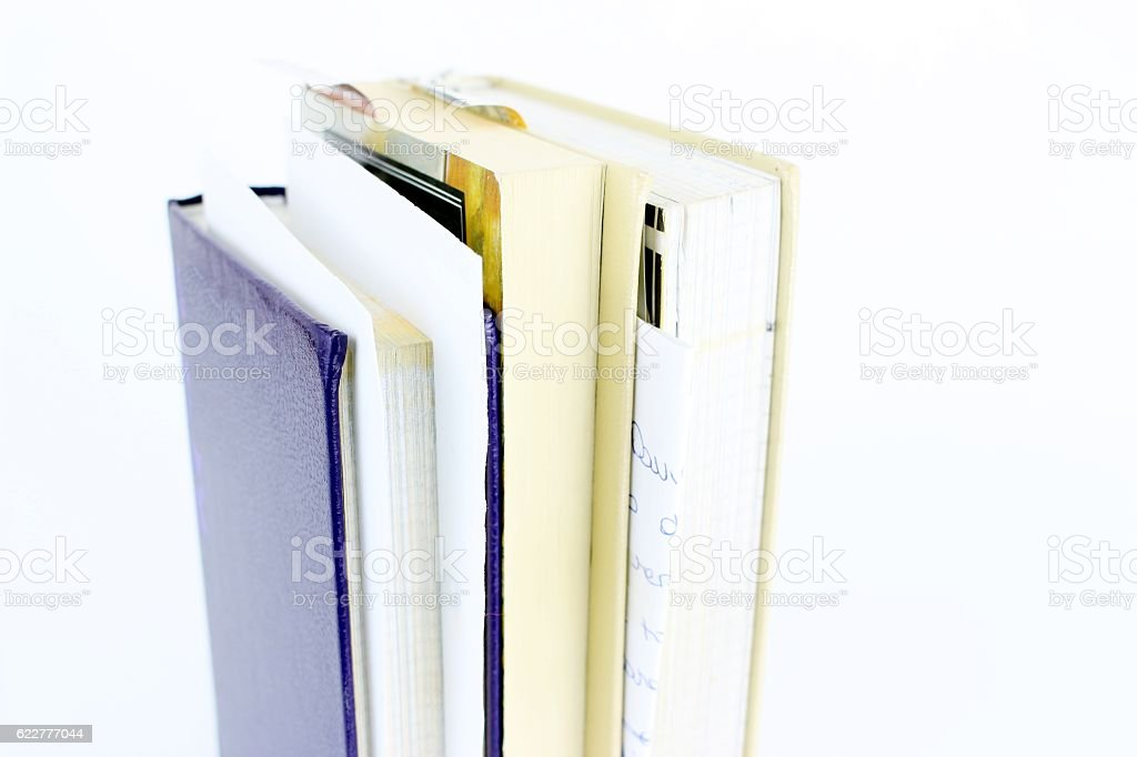 Second hand books on white background stock photo