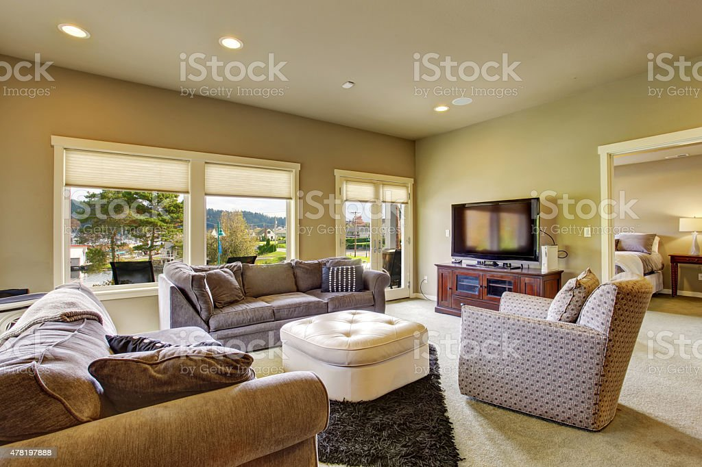 Secondary living room with carpet and windows. stock photo