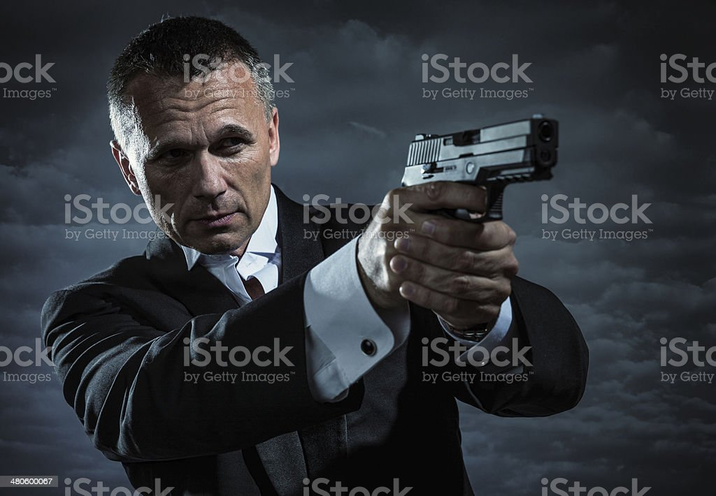 Secret Agent Armed With Handgun stock photo