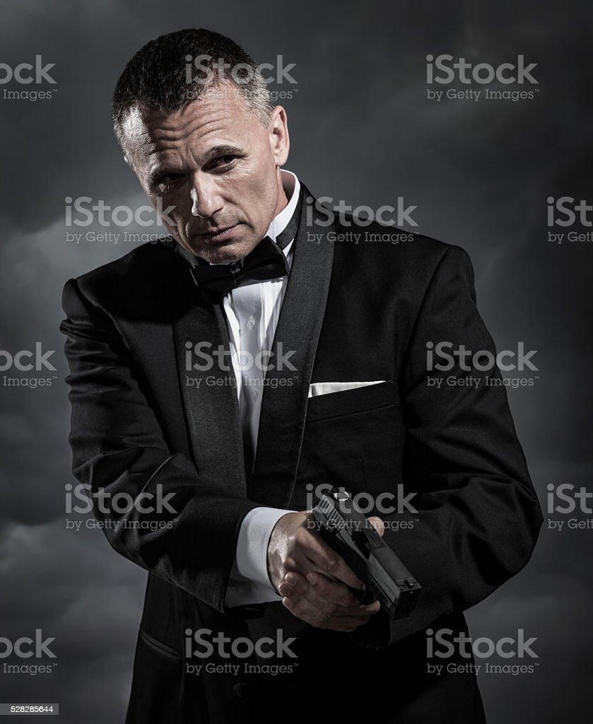 Secret Agent with Handgun stock photo