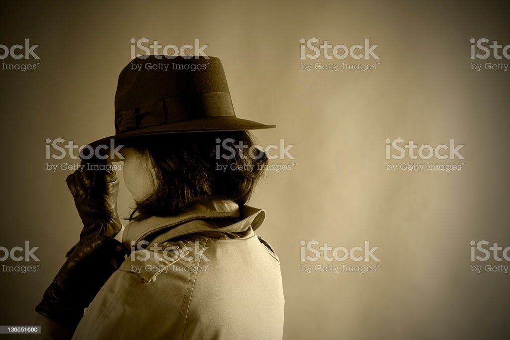 Secret Agent woman. 1940s style. Sepia. Old-fashioned. stock photo