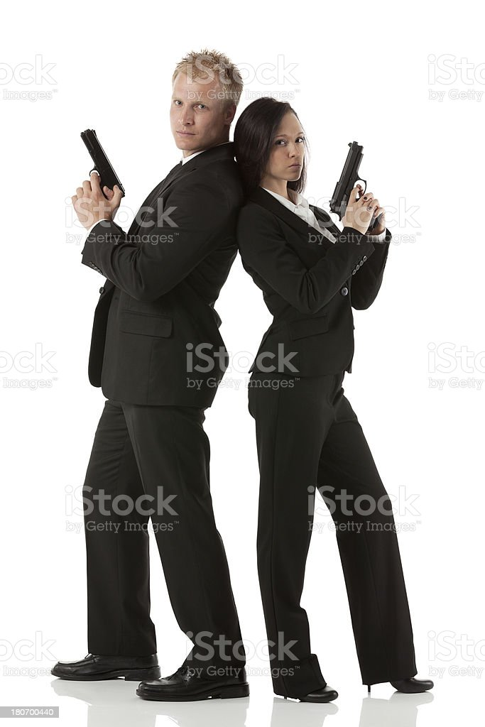 Secret agents with hand guns royalty-free stock photo