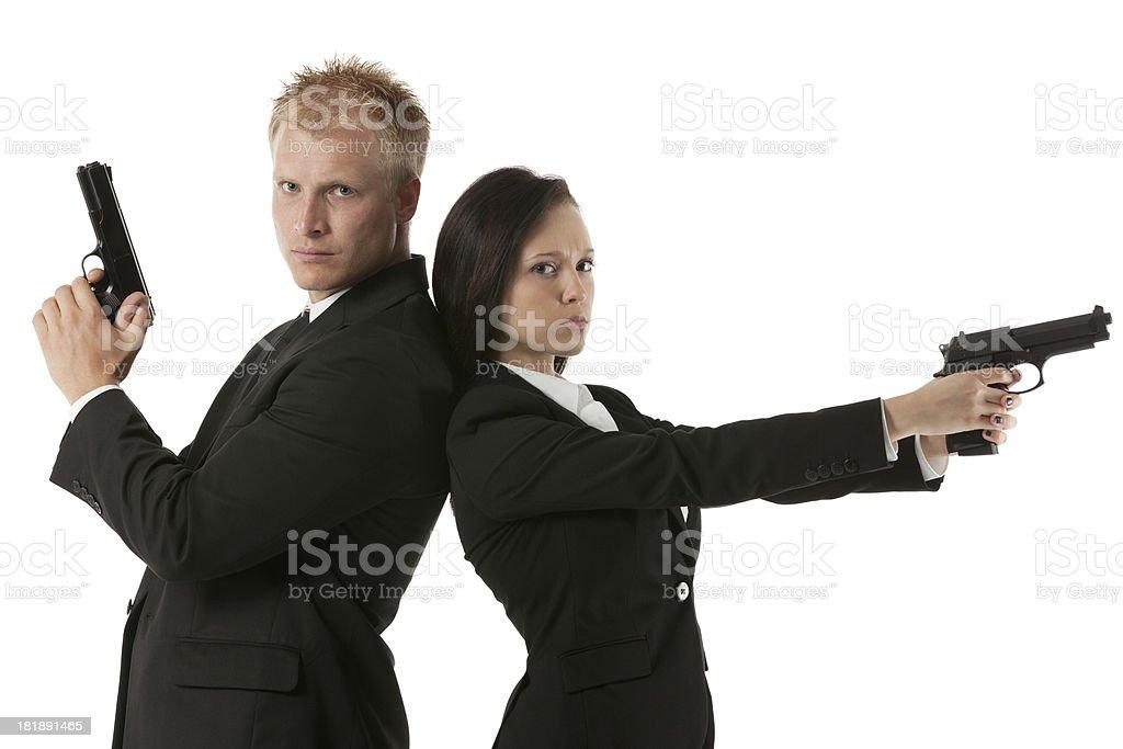 Secret agents with handguns royalty-free stock photo