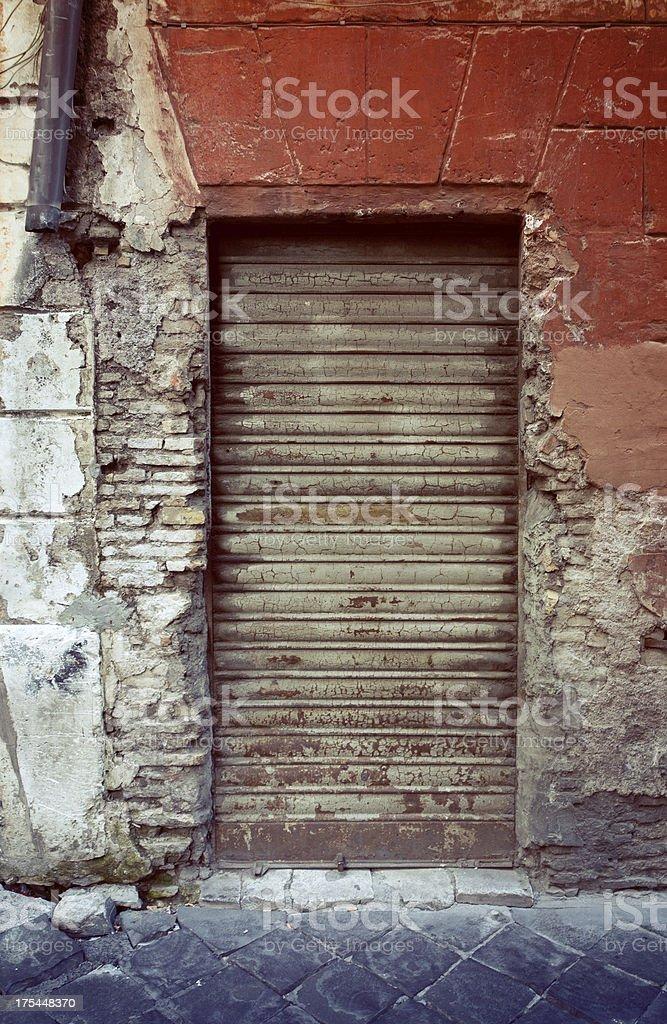 Secret Corners of Rome: Old Shop Shutter stock photo