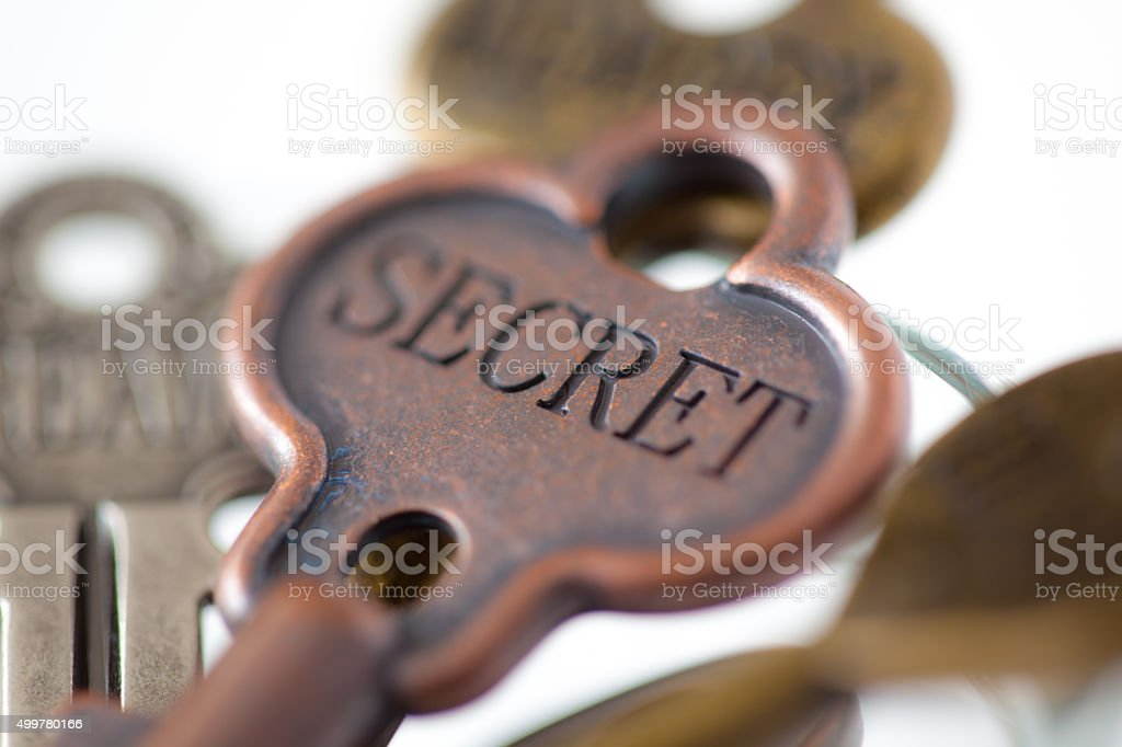Secret engraved on an old fashioned key. stock photo
