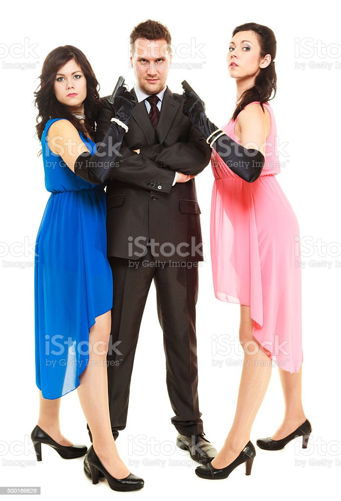 Secret investigation with two women and one man stock photo