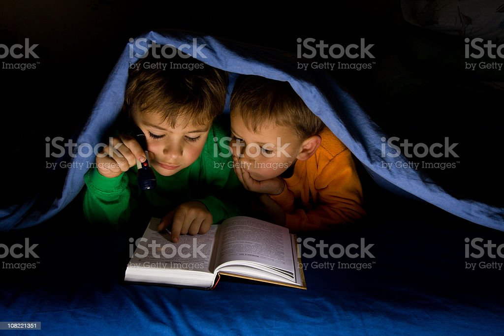 Secret night time reading stock photo