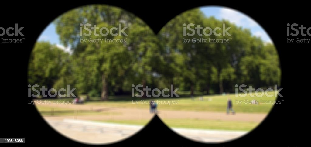 Secret police agent watches through binoculars for suspects stock photo