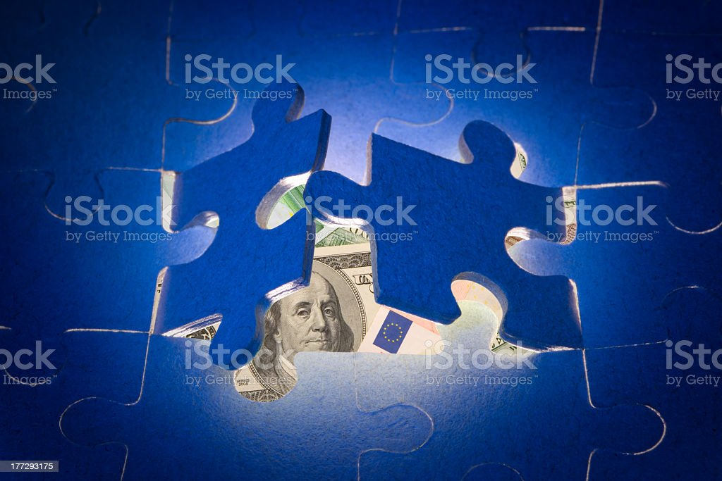 Secret profit (dollars and puzzles) stock photo