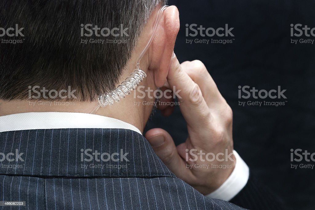 Secret Service Agent Listens To Earpiece, Behind stock photo