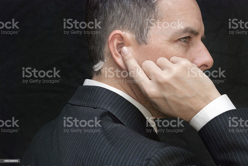 Secret Service Agent Listens To Earpiece, Side stock photo