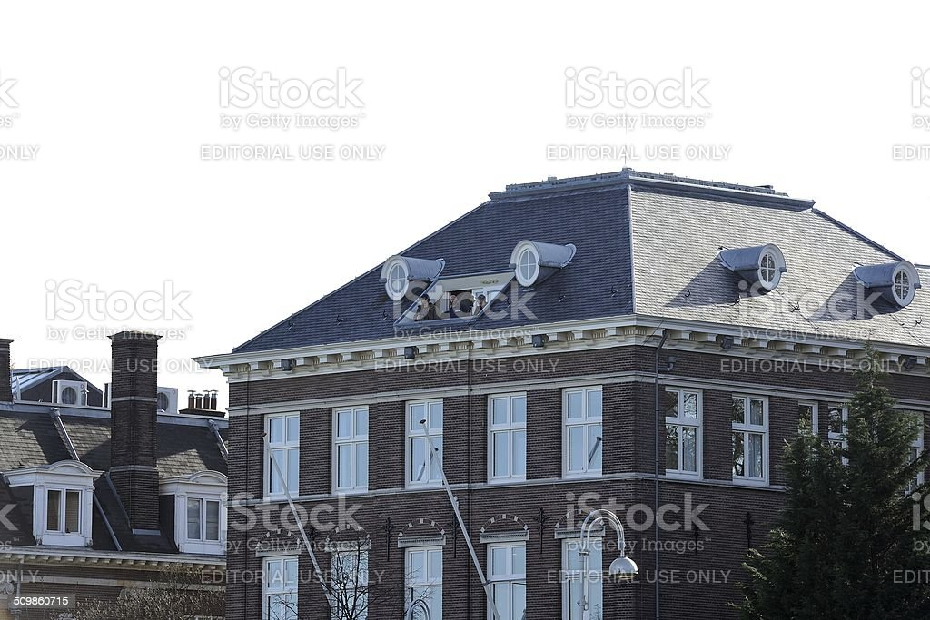 Secret Service agents watch crowd from rooftop. stock photo