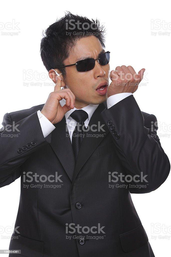 Secret Service communicating earphone stock photo