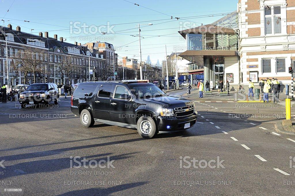 US Secret Service vehicles pass the Concertgebouw In Amsterdam stock photo