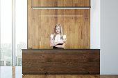 Secretary at wooden reception