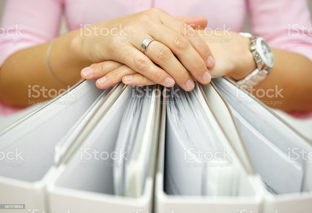 Secretary holding binders, concept of accounting,business,documentation,paperwork stock photo
