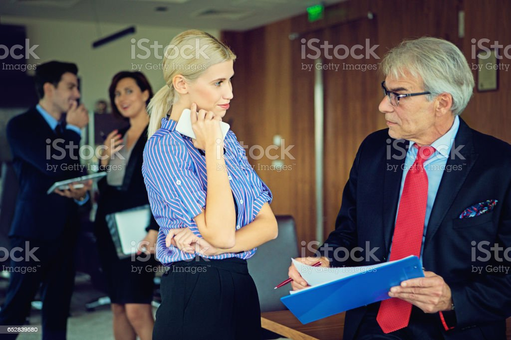 Secretary is flirting with her boss stock photo