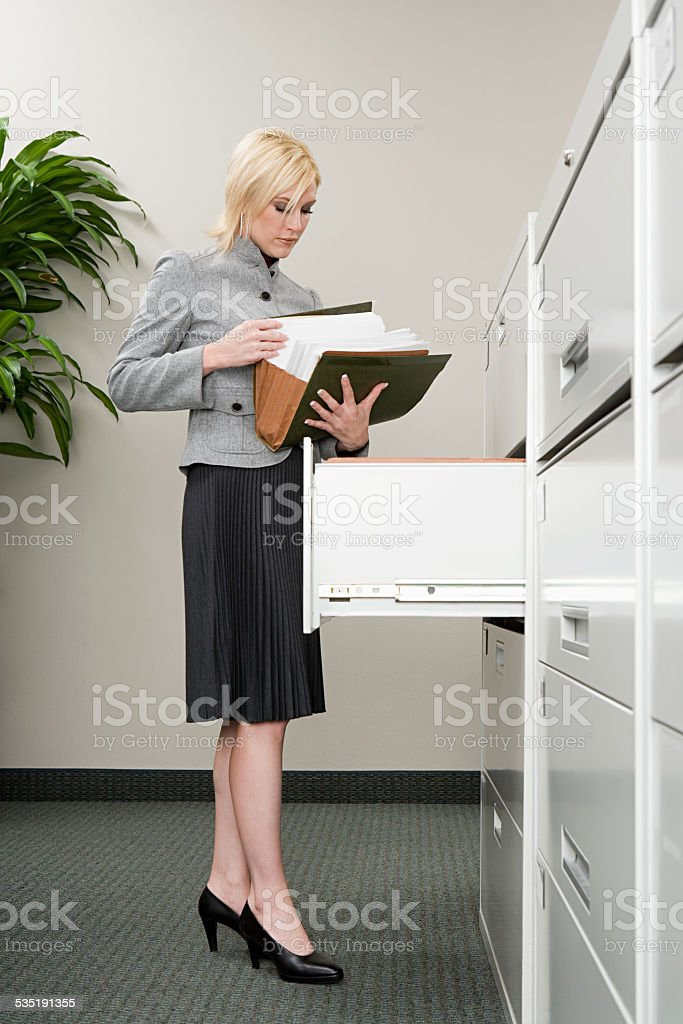 Secretary looking at files stock photo