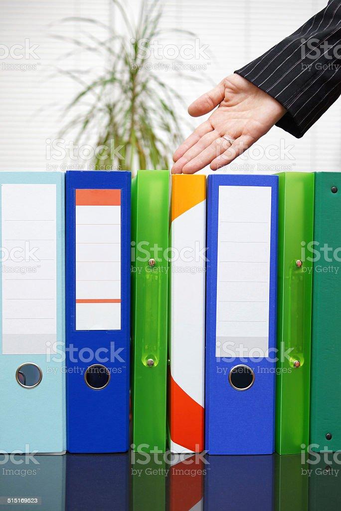 secretary shows well-organized documentation stock photo
