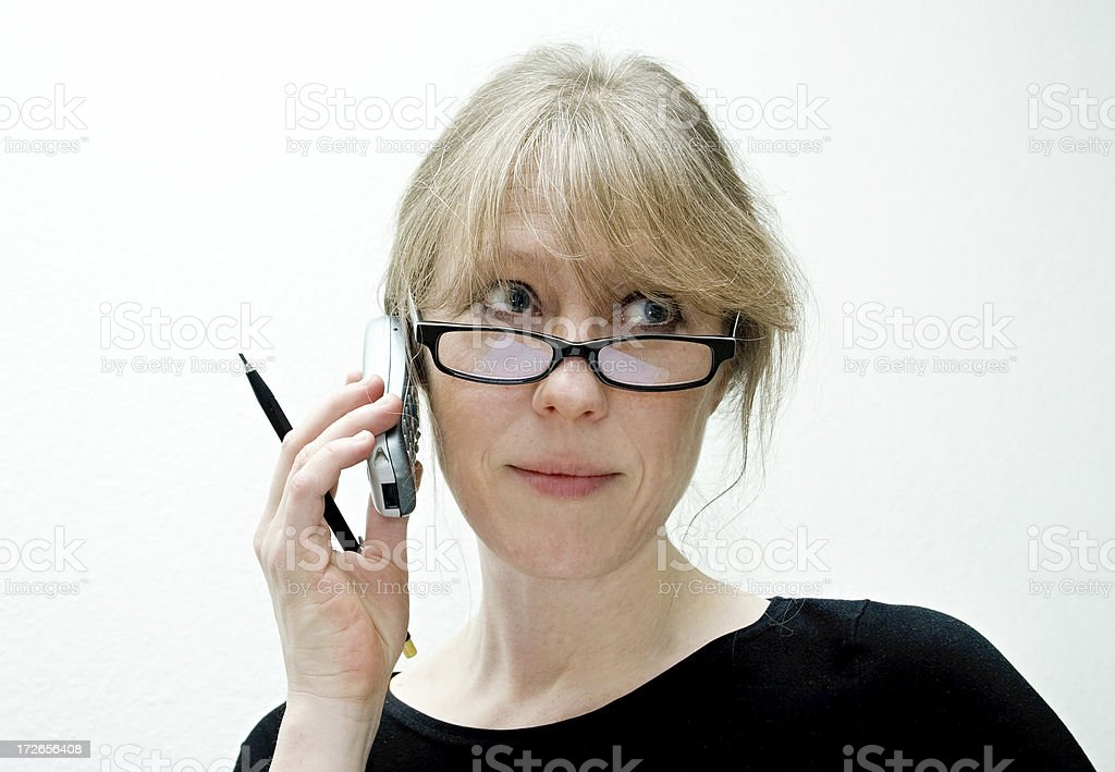 Secretary with mobile and pen royalty-free stock photo