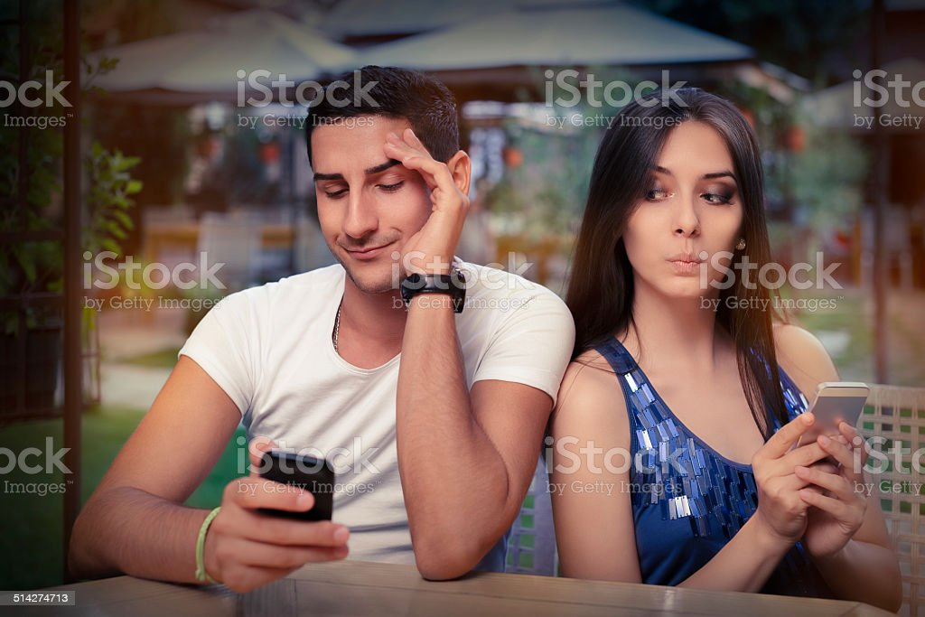 Secretive Couple with Smart Phones in Their Hands stock photo
