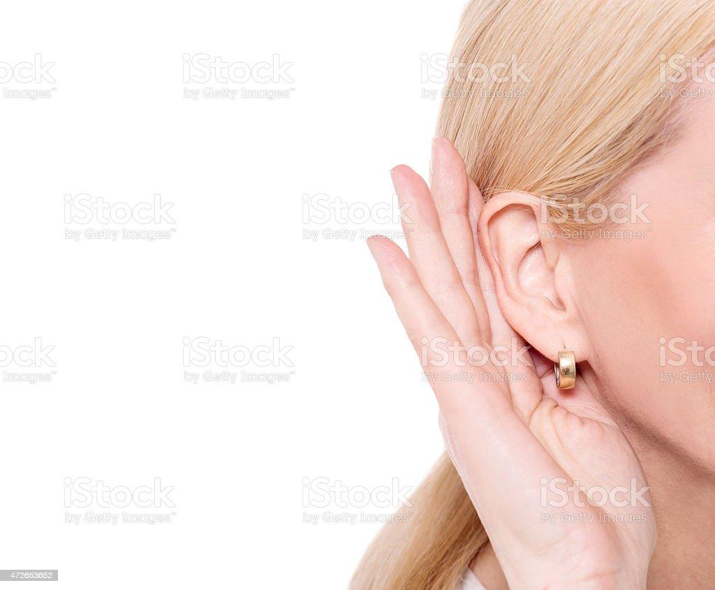 Secretly listen the gossip. stock photo