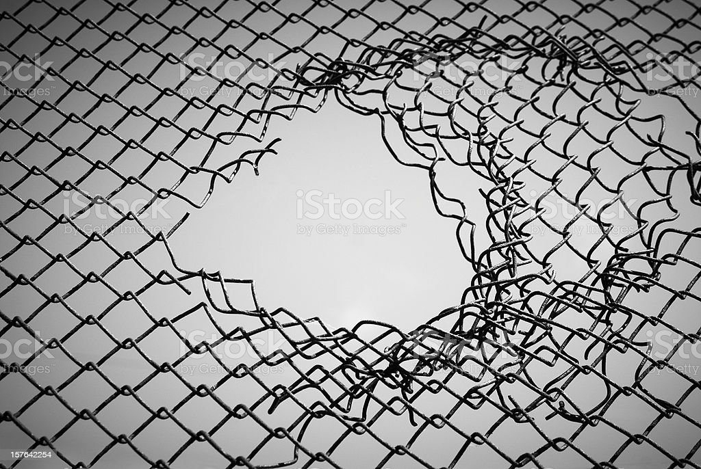 Section of wire mesh with a hole in the middle stock photo