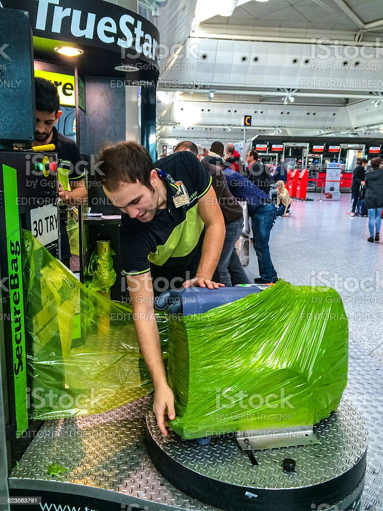 Secure Bag Wrapping service in Ataturk Airport, Istanbul stock photo