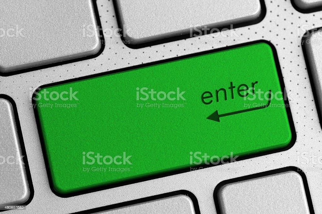 secure internet concept - green enter button stock photo