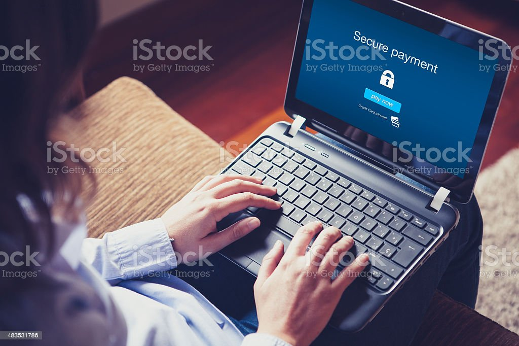 Secure payment on the screen. stock photo