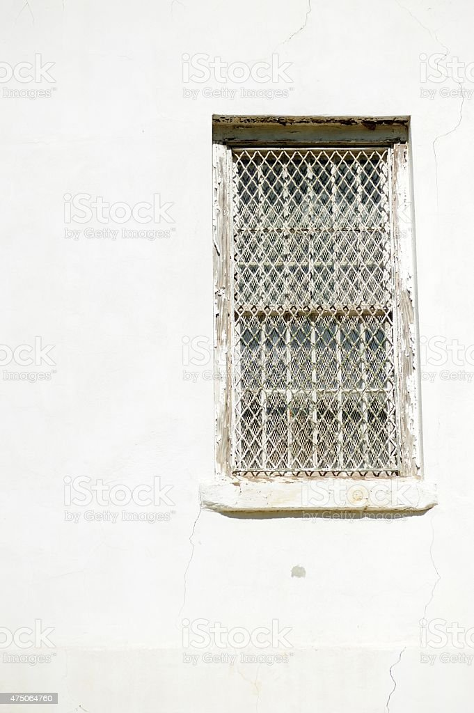 Secured window in white wall stock photo