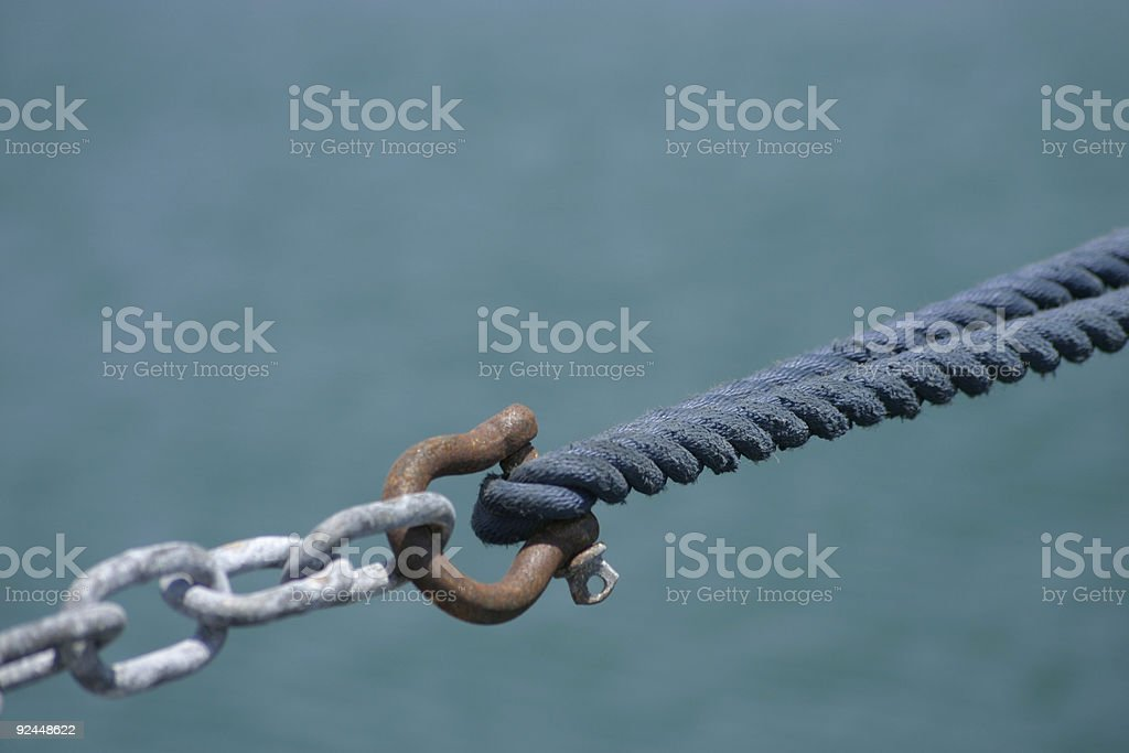 Securing a yacht royalty-free stock photo