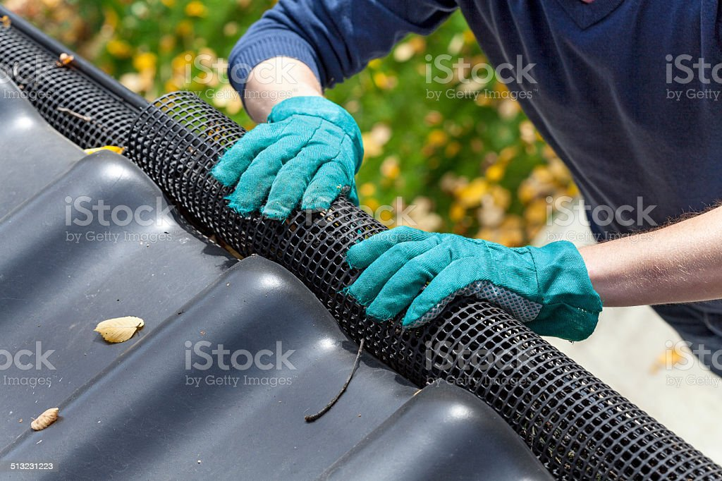 Securing gutters stock photo