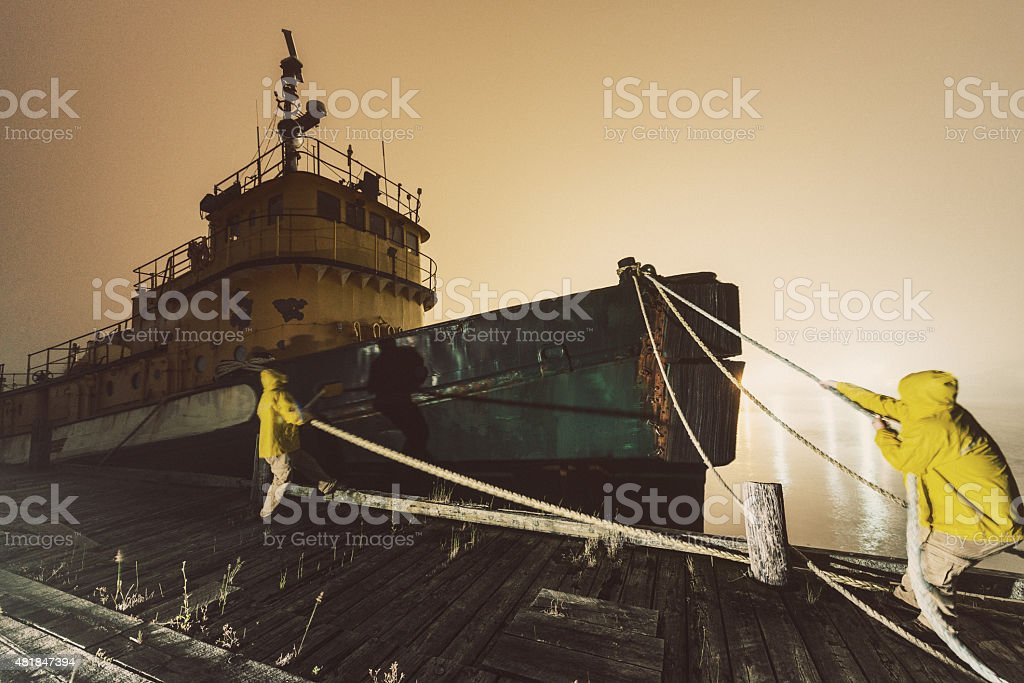 Securing The Mooring Lines stock photo