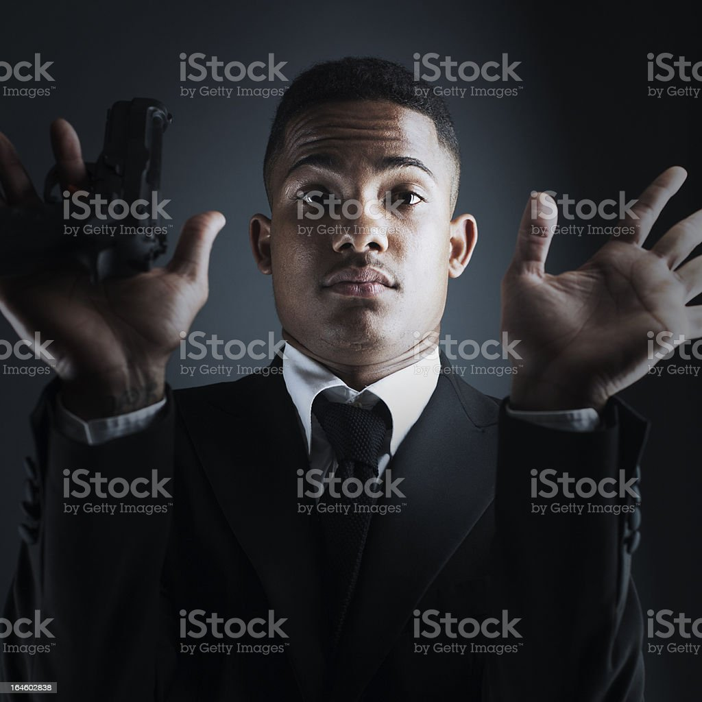 Security agent or criminal holding a hand gun. royalty-free stock photo