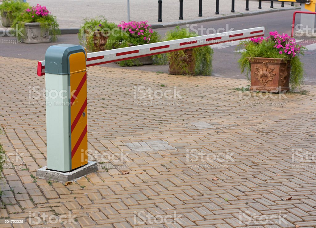 Security barrier for parking vehicles stock photo