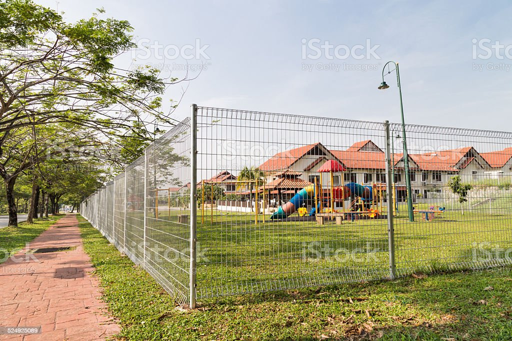 Security boundary fencing at residential community stock photo