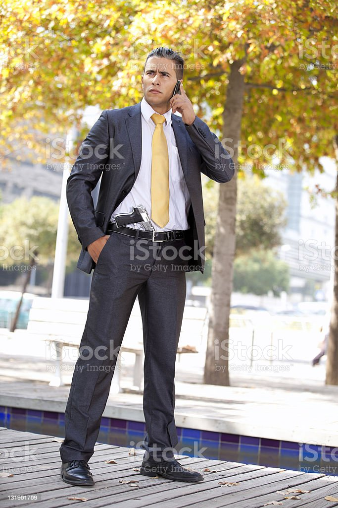 Security Businessman with a handgun royalty-free stock photo