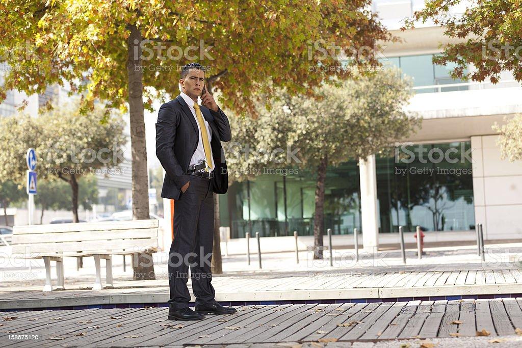 Security Businessman with a handgun stock photo
