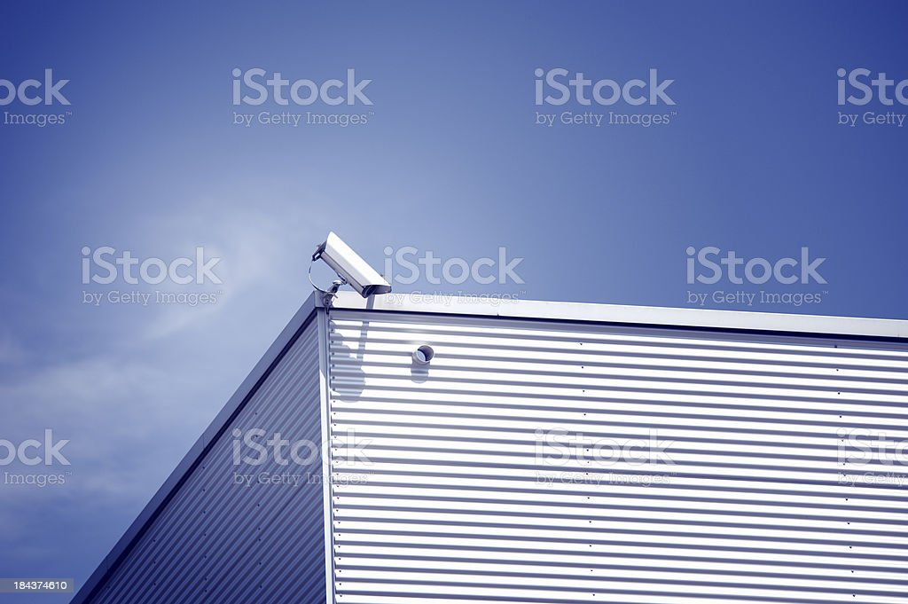 Security camera against blue sky royalty-free stock photo