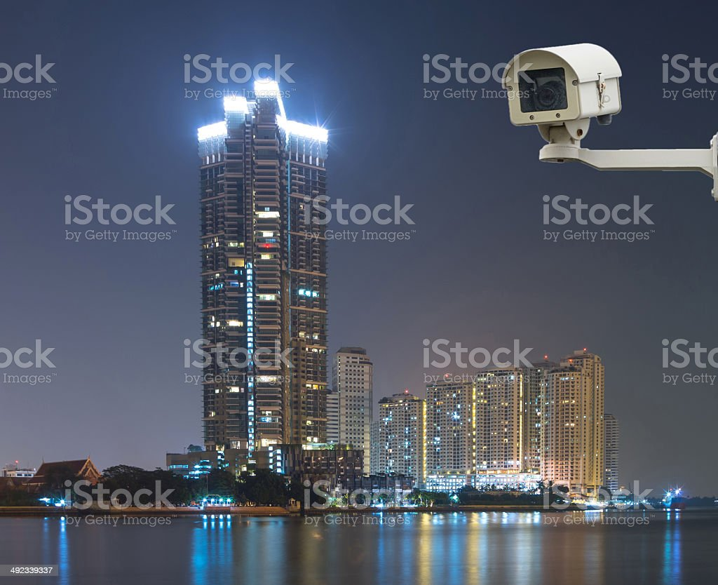 Security camera monitoring the cityscape river view at twilight stock photo